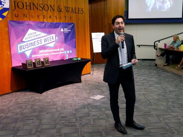 Nick Quinlan presents award at JA Business Week closing ceremony