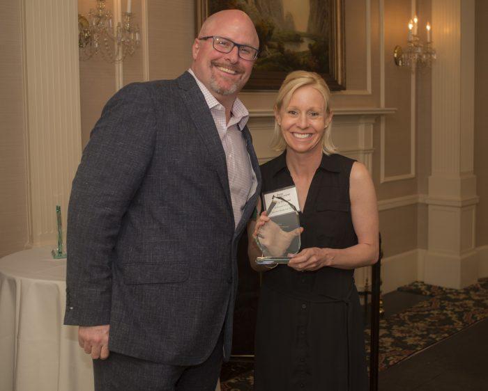Hilary Wimmer holding award