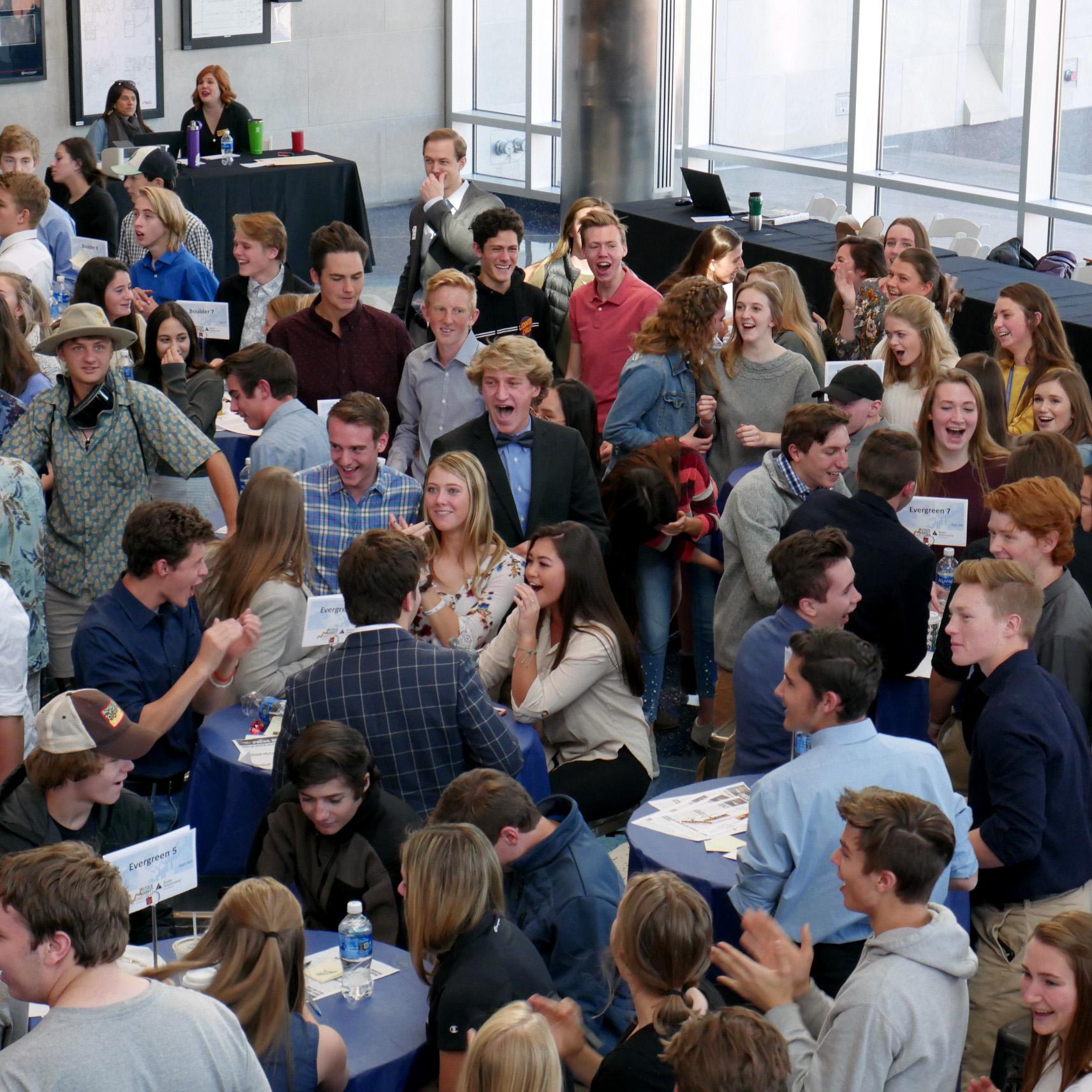 Crowd of students cheering at Junior Achievement Stock Market Challenge, presented by Wells Fargo