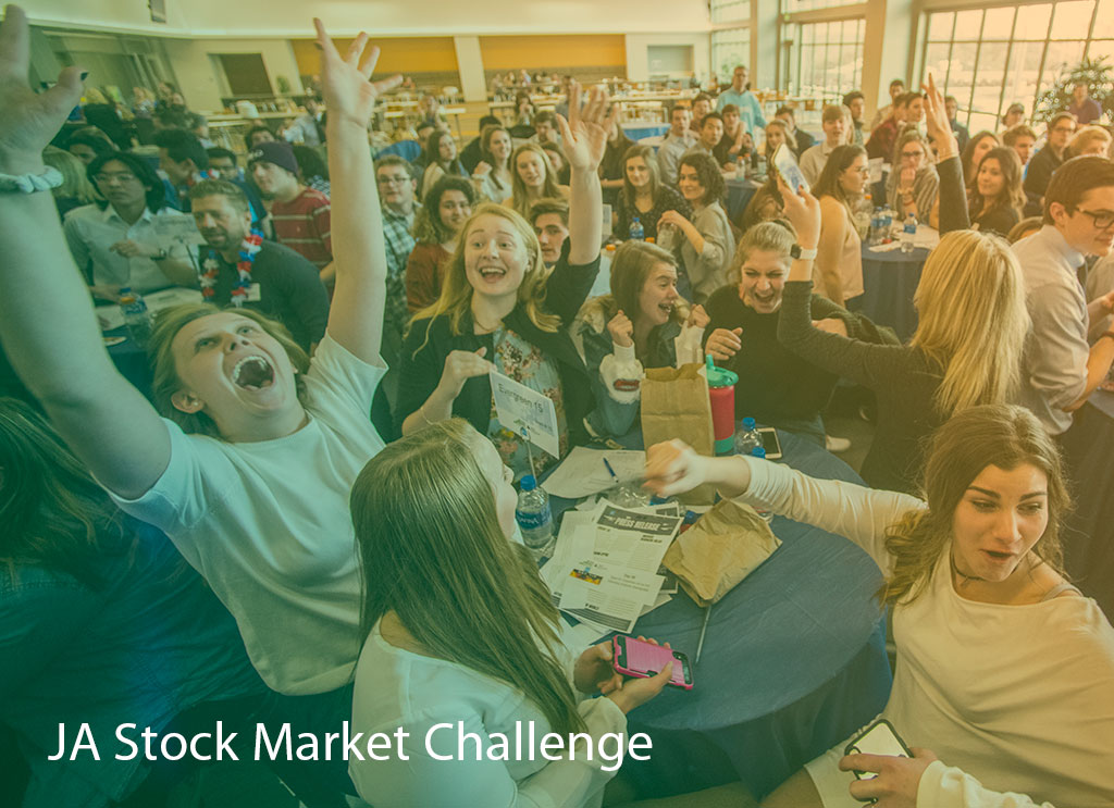 Crowd of high school students cheering at the JA Stock Market Challenge.