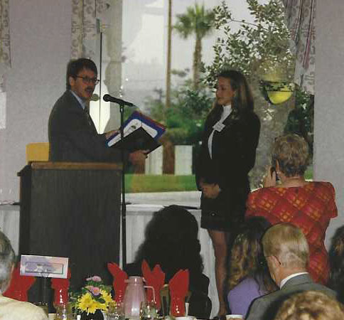 Erica Costanzo earning an award as a high school student in 1997.